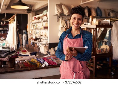 Portrait Of Female Owner Of Gift Store With Digital Tablet