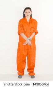 Portrait of female prisoner in orange uniform