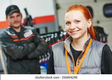 Portrait of female repairman auto mechanic in car auto repair or maintenance shop service station