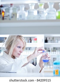 portrait of a female researcher doing research in a lab (color toned image)