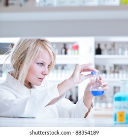 portrait of a female researcher/chemistry student carrying out research in a lab