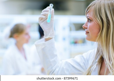 portrait of female researchers/chemistry student carrying out research in a chemistry lab (color toned image; shallow DOF)