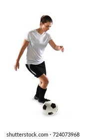 Portrait of female soccer player controlling ball isolated over white background