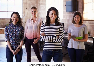 Portrait Of Female Staff Standing In Modern Design Office
