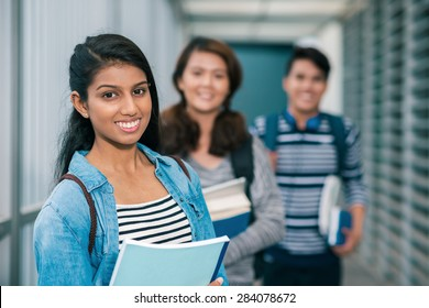 Portrait of female student with her friends in the background