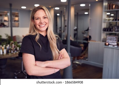 Portrait Of Female Stylist Or Business Owner In Hairdressing Salon