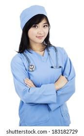 Portrait of female surgeon posing on white background