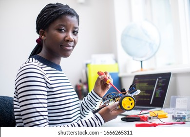 Portrait Of Female Teenage Pupil Building Robot Car In Science Lesson - Shutterstock ID 1666265311