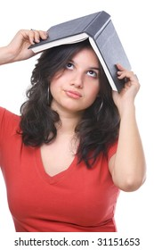 A portrait of female teenager holding book on her head