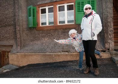 Portrait of female tourist in the alpine small town