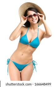 Portrait of female wearing bikini, hat and sunglasses, isolated on white. Concept of summer holidays and traveling