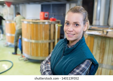 portrait of female worker in a microbrewery