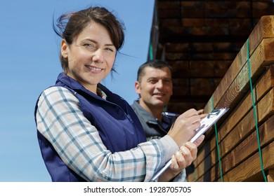portrait of female worker in wood yard