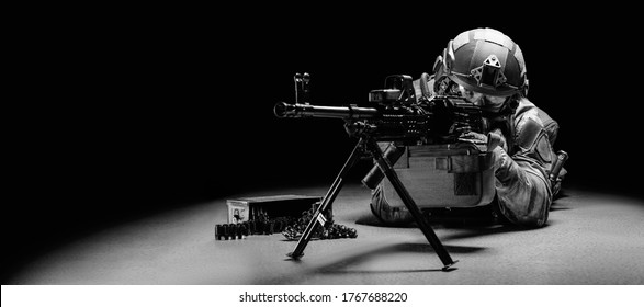 Portrait of a fighter of a special unit. He lies on the ground and shoots from a heavy machine gun. SWAT concept. Mixed media