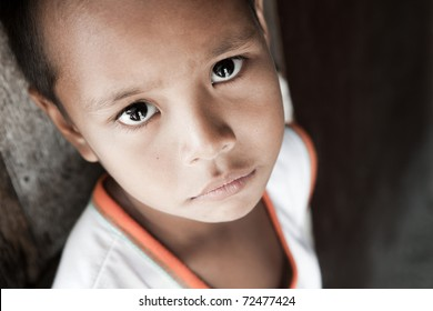 Portrait of a Filipino boy living in poverty - natural light - Manila, Philippines.