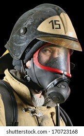 Portrait of a firefighter in breathing apparatus on a black background