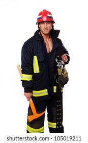 Portrait of fireman posing in studio with equipment