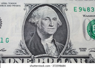 portrait of the first president of the United States, the US founding father George Washington on the one dollar bill, background of the money, one dollar bills front side obverse. close up, America
