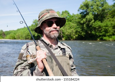Portrait of a fisherman on a fishing trip on the river.