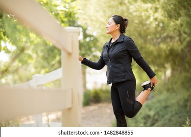 Portrait of a fit Asian woman exercising outside.