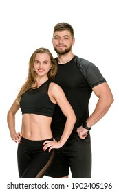 Portrait of fit athletic couple posing together on white studio background