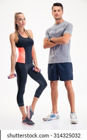 Portrait of a fitness couple standing isolated on a white background