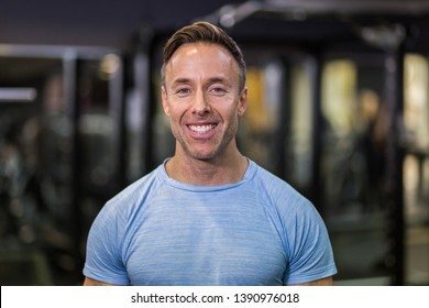 Portrait of fitness man smiling at the gym.