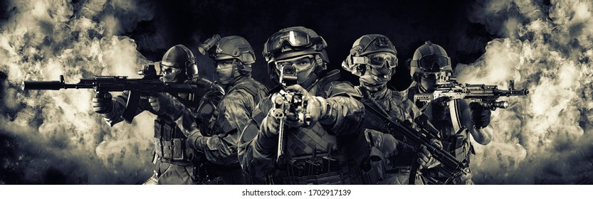 Portrait of five military men. A group of soldiers on a background of smoke. The concept of military operations, special operations, paintball. Mixed media