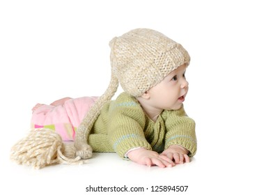 Portrait of five months old baby girl wearing knitted winter hat