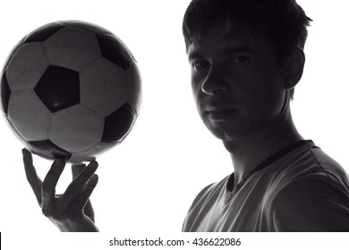 portrait of a football player with the ball