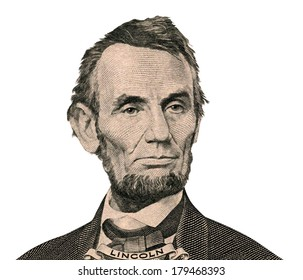 Portrait of former U.S. president Abraham Lincoln as he looks on five dollar bill obverse. Clipping path inside.