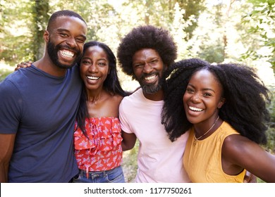 Portrait of four black adult friends on a walk in the forest
