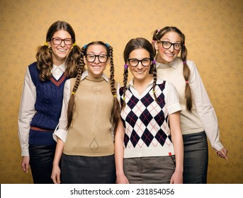 Portrait of four female nerds