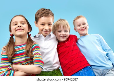 Portrait of four kids looking at camera with a confident smile