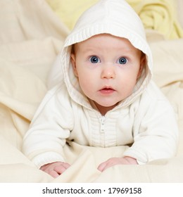 Portrait of four month baby girl wearing hood