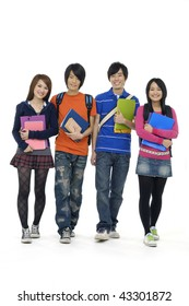 Portrait of four students with notebooks and paper folders posing