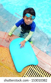 Portrait of four years old boy with swimming accessories