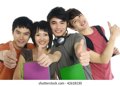 Portrait of four young laughing and giving the thumbs-up sign.
