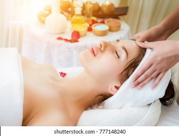 Portrait of fresh and beautiful brunette woman taking head and face massage, in spa salon wellness, Beauty healthy lifestyle and relaxation.