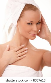 Portrait of Fresh and Beautiful brunette woman wearing white towel on her head