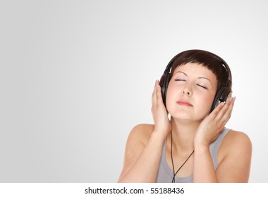 Portrait of Fresh and Beautiful sexy young woman with headphones
