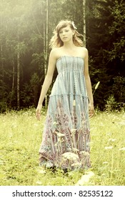 Portrait of a fresh and lovely young woman in summer garden. Fashion shot