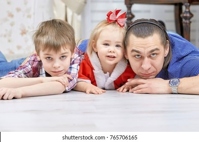 Portrait of friendly family looking at camera on Christmas evening. Winter holiday Xmas and New Year concept