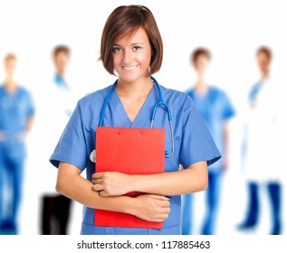 Portrait of a friendly female doctor in front of a medical team