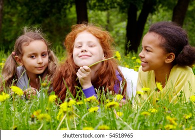 Portrait of friendly girls relaxing in park on summer day
