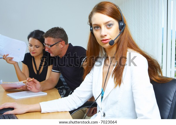 portrait of A friendly secretary/telephone operator in an office environment.