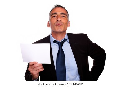 Portrait of a friendly senior businessman holding a white card with copyspace while having fun on isolated background