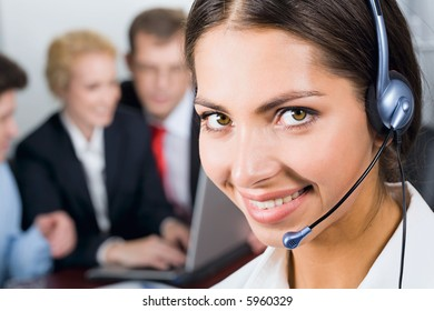 Portrait of friendly smiling business woman with headset