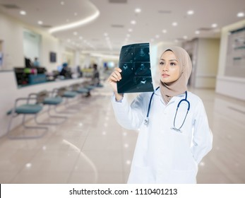 portrait of friendly, smiling confident muslim female doctor.
