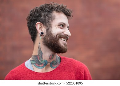 Portrait of a friendly tattooed man in his thirties
